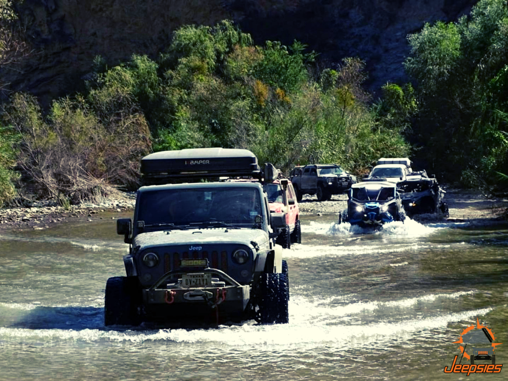 Jeep With Roof Top Tent Crossing Water